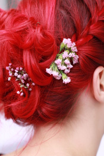 Close-Up Of Woman With Red Flowers