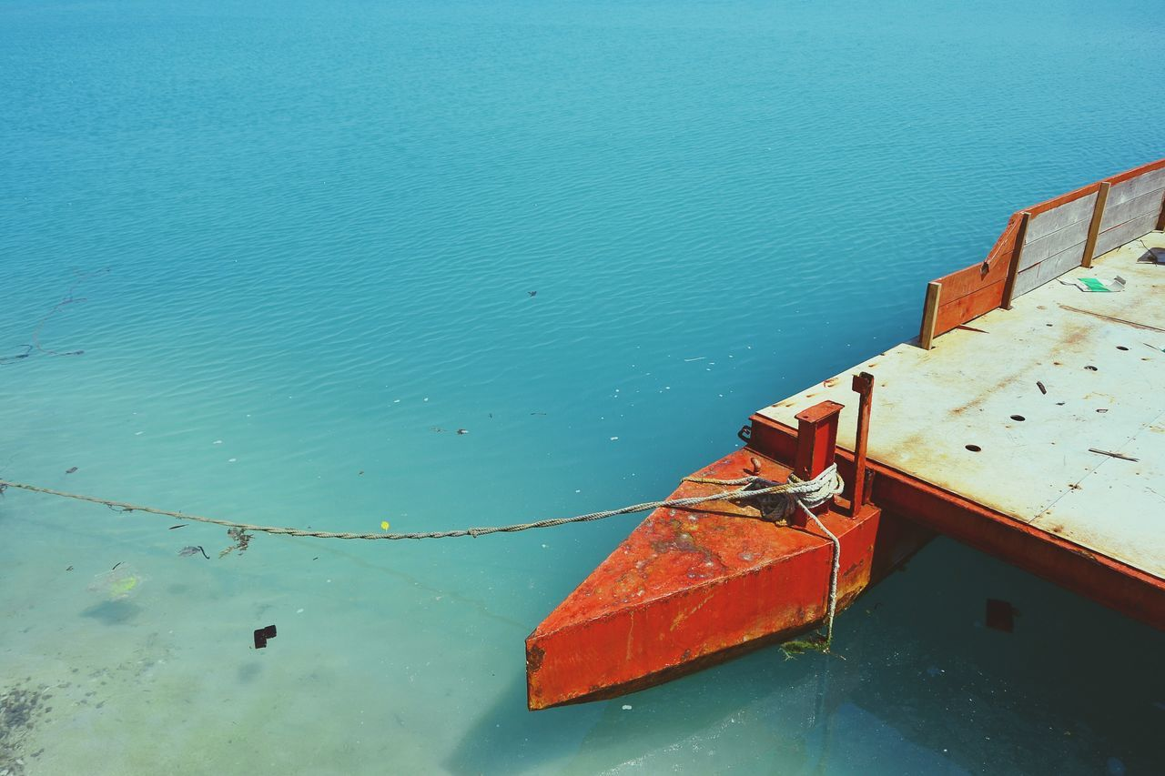 nautical vessel, water, transportation, no people, mode of transport, nature, day, high angle view, sea, outdoors, moored, tranquility, red, blue, beauty in nature, close-up, sky