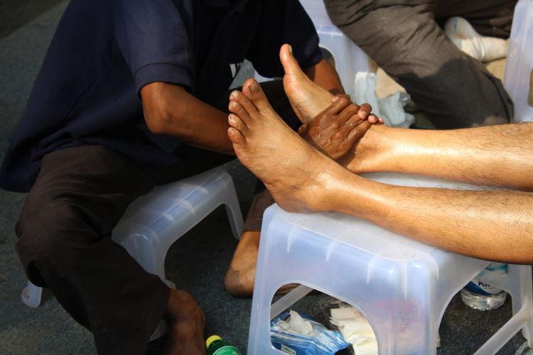 Massage Therapist Massaging Legs At Spa