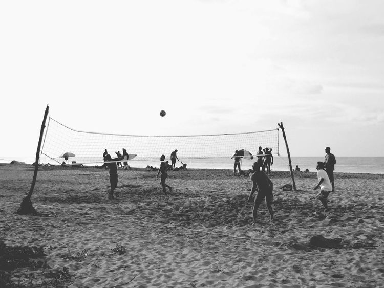 Monochrome Photography Net - Sports Equipment Volleyball - Sport Playing Beach Lifestyles Beach Volleyball Large Group Of People Sea Leisure Activity Sport Outdoors Beauty In Nature