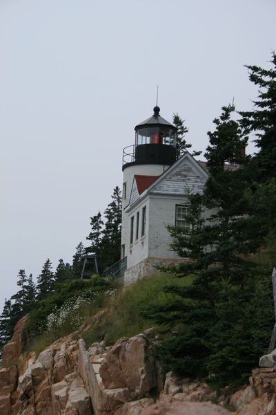 Oceanside Architecture Beauty In Nature Built Structure Coastal Coastal Life Grass House Lighthouse Lighthouse_lovers Maine Nature No People Ocean View Outdoors Peaceful Scenic Solitude Tranquility Sky Travel Tree Building Exterior Rock Formation Bass Harbor Lighthouse