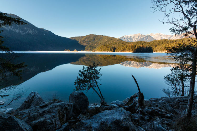 Bavaria Eibsee at the Zugspitze in winter Berge Eibsee Beauty In Nature Day Idyllic Lake Mountain Mountain Range Nature No People Non-urban Scene Outdoors Plant Reflection Remote Scenics - Nature See Sky Tranquil Scene Tranquility Tree Water