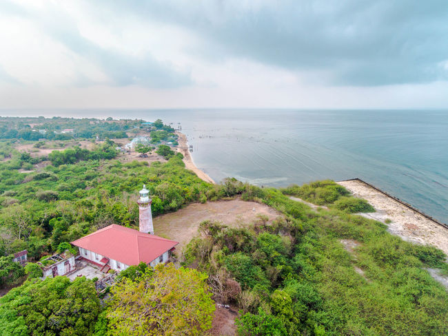 Architecture Beauty In Nature Building Exterior Built Structure Day EyeemPhilippines Grass High Angle View Horizon Over Water Lighthouse Nature No People Outdoors Scenics Sea Sky Tranquility Water