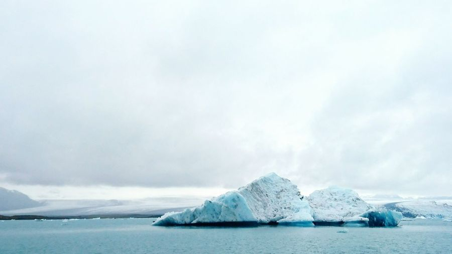 Scenic view of icebergs at jokulsarlon against sky