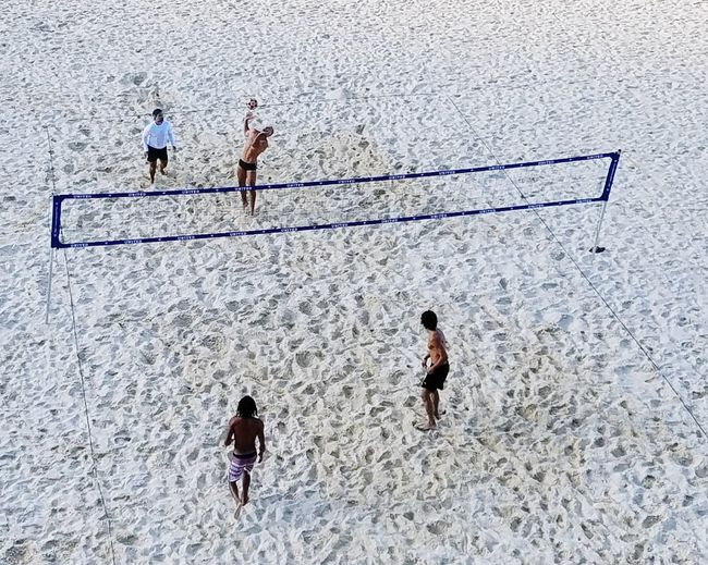 High angle view of men playing on beach