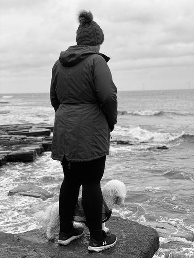 Rear view of man looking at sea shore