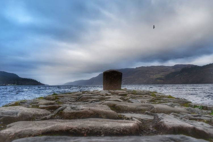 Looking across Loch Ness from a small jetty at 7.30 p.m. in the evening Loch Ness Evening Sky Water Scottish Highlands Malephotographerofthemonth Seascape Lochs Water Sea Sky Cloud - Sky Landscape Weather Cold Cold Temperature Weather Condition