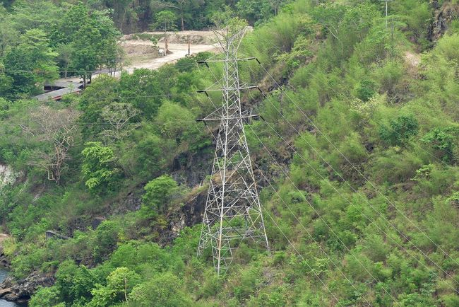 High-Voltage Power Transmission Tower Near Riverside Power Nature Riverside Transmission Beauty In Nature Cable Day Energy Environment Fuel And Power Generation High Angle View High-voltage Land No People Outdoor Tower