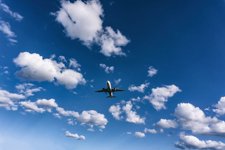 Aircraft Approaching Airport Against Sky with Clouds Berlin Germany 🇩🇪 Deutschland Color Image Horizontal No People Outdoors Air Vehicle Sky Cloud - Sky Airplane Flying Transportation Mode Of Transportation Low Angle View Mid-air Blue Day Nature Travel Motion on the move Public Transportation Beauty In Nature Commercial Airplane Plane
