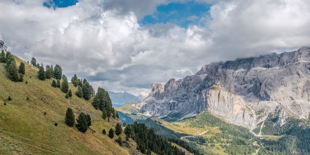 Sellajoch, Sella The Great Outdoors - 2019 EyeEm Awards Mountain Ridge Pine Woodland Mountain Peak Snowcapped Mountain Cloud - Sky Mountain Range Landscape Sky Pinaceae Beauty Mountain Tree Natural Landmark Mountain View Alpine Landscape Alps Alpen Südtirol Dolomites Dramatic Landscape Betterlandscapes Beauty In Nature Paysages Grys