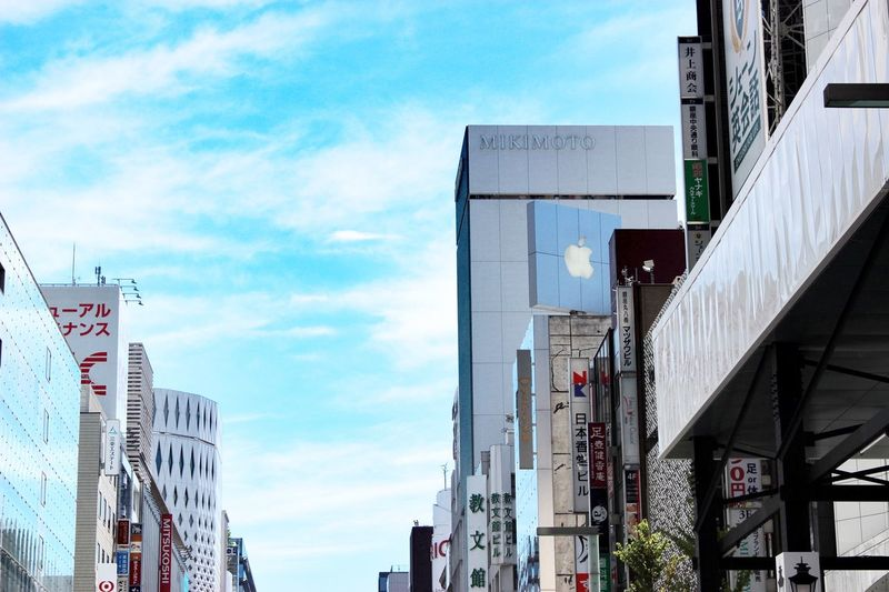 the layer of the day Architecture Built Structure Sky Building Exterior Cloud - Sky City Day No People Office Building Low Angle View Outdoors Sign Modern Office Building Exterior Street