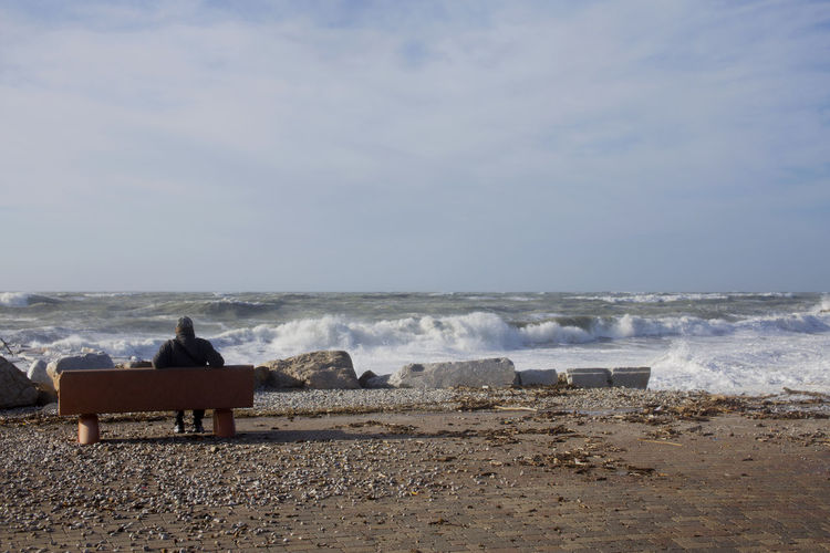 Water Sea Sky Beach Horizon Over Water Motion Beauty In Nature Horizon Nature Day Scenics - Nature Sitting Seat Power In Nature Flowing Water Man Solitude Solitude And Silence Solitary Solitary Moments Tranquility Tranquil Scene