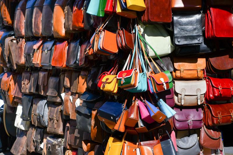Full frame shot of multi colored purses at market