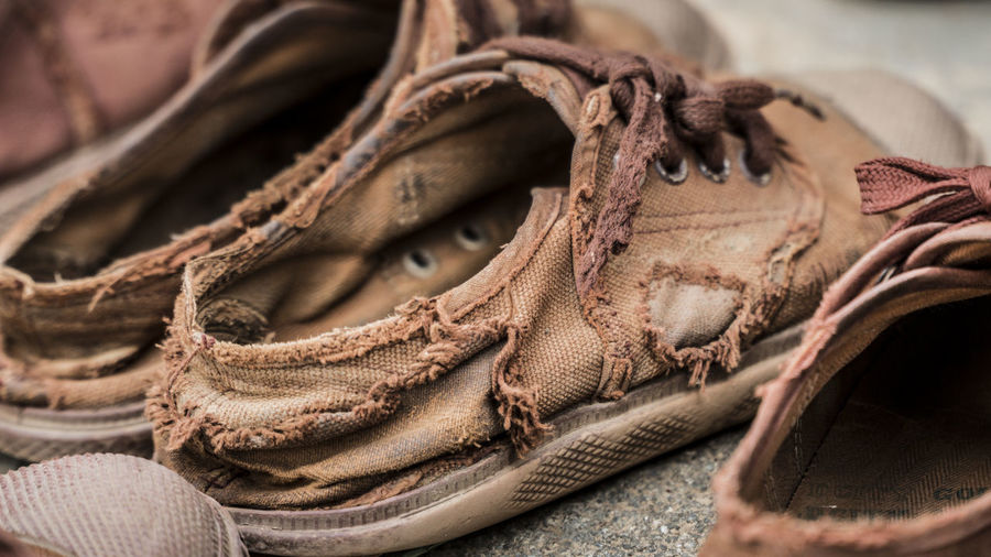Close-up of weathered shoes