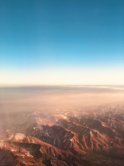 Aerial view of landscape against clear sky during sunset