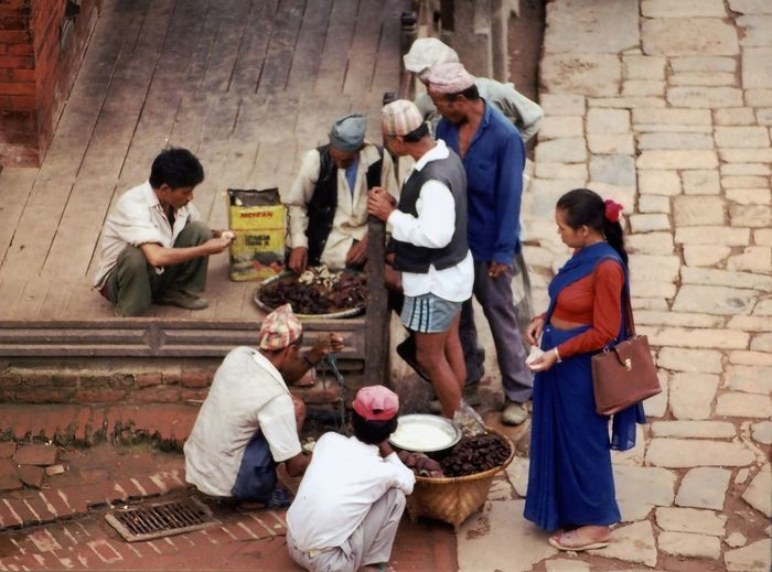 Street vendors and customers at Bhaktapur, Nepal. Bargaining Nepal Adult Adults Only Bhaktapur Day Full Length Group Of People Haggling Marketplace Mature Adult Men Outdoors People Young Adult