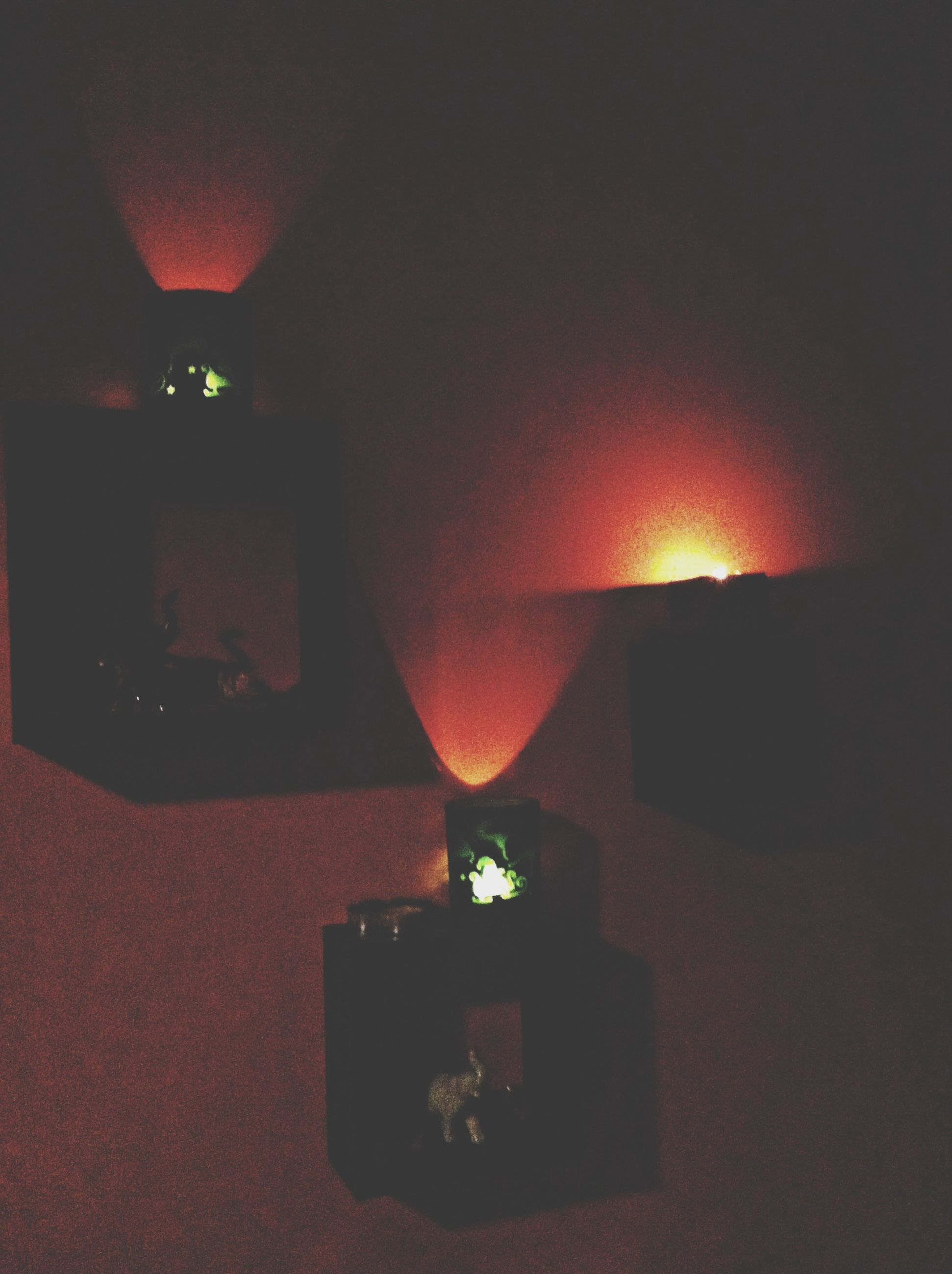 illuminated, indoors, lighting equipment, night, wall - building feature, dark, home interior, built structure, architecture, house, light - natural phenomenon, electricity, electric lamp, no people, lantern, glowing, orange color, close-up, wall, copy space