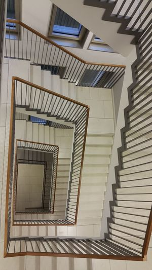 Spiral Staircase Hand Rail Spiral Stairs Stairs Steps And Staircases Spiral Steps Staircase Railing Design Building Story Office Building City Location High Rise Zigzag