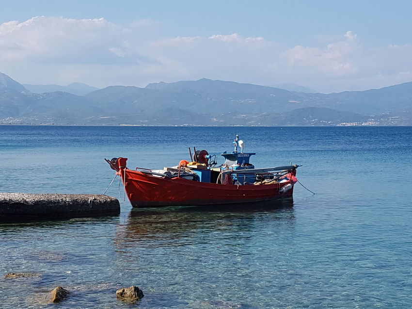 Yalos Beauty In Nature Cloud - Sky Day Marine Mode Of Transport Mountain Mountain Range Nature Nautical Vessel No People Outdoors Sailing Scenics Sea Sky Tranquility Transportation Water Waterfront