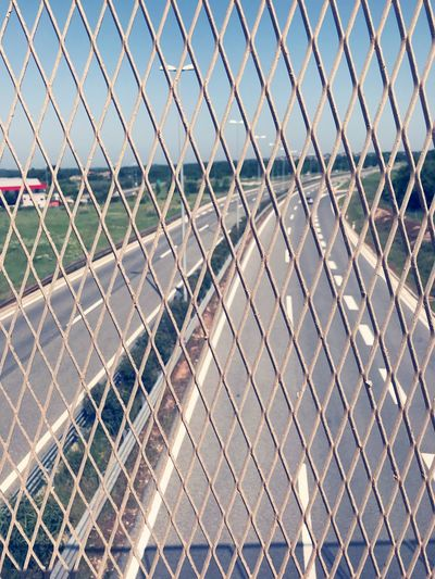 Highways seen through chainlink fence