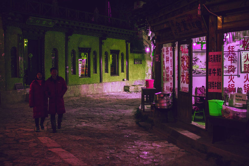 China Yunnan ,China Zhongdian Architecture Built Structure Building Exterior Night Illuminated Building Real People People Women Full Length City Adult Lifestyles Rear View Men Walking Street Outdoors Shangri-La