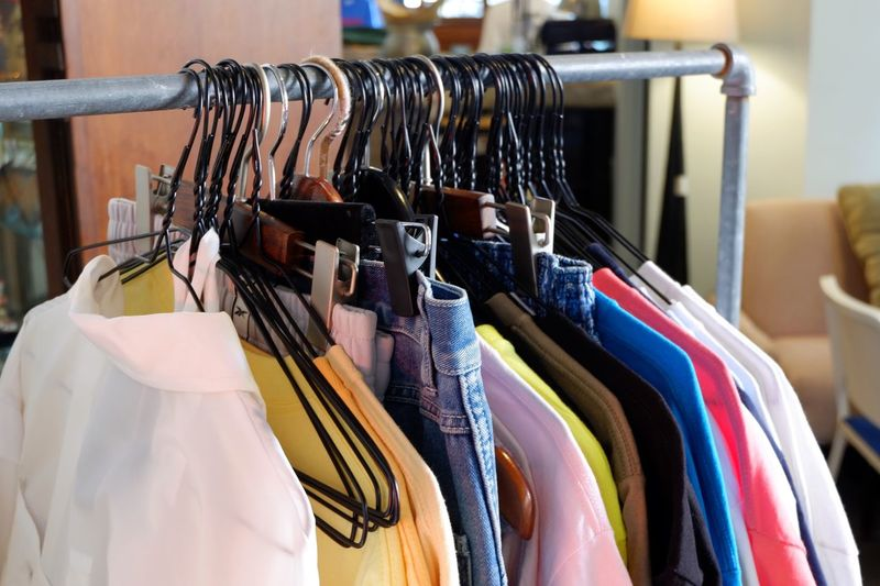Row of colorful fashionable clothes with hanger on metallic rack at shop, selective focus Styling Style Showroom Trend Fashion Trendy Lifestyles Collection Retail  Shopping Row T Shirt Clothes Colorful Hanging Coathanger Clothing Clothes Rack In A Row Rack Fashion Clothing Store Store Multi Colored Close-up