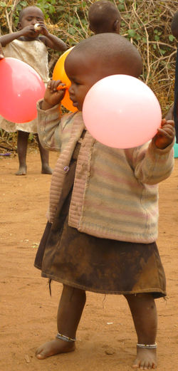 Africa African People Balloon Day Full Length Little Girl One Person Outdoors People Real People Standing Village Life Women