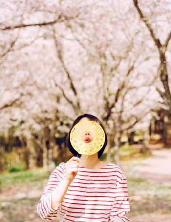Film Filmisnotdead Analogue Photography 35mm Film Capture The Moment Spring Cherry Blossoms Pink One Person Portrait Day Bubbles Tree Holding Nature Daylight Light And Shadow Real People Stripes Pattern Fashion Fresh On Market 2017