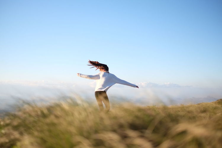 """""""Just go wild"""", I said. And she did. Dance Dancing Free Freedom Girl Grassland Happiness Model Nature Nature Outdoor Photography Outdoors Outside Red Head Sky Teenager Wildlife Young Adult Social Advertising Collection"""
