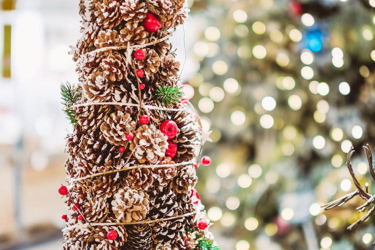Tree Focus On Foreground Celebration Christmas Decoration Decoration Christmas Holiday christmas tree Close-up Christmas Ornament Celebration Event Holiday - Event Event Plant Illuminated No People Indoors  Ornament Festival Fir Cone