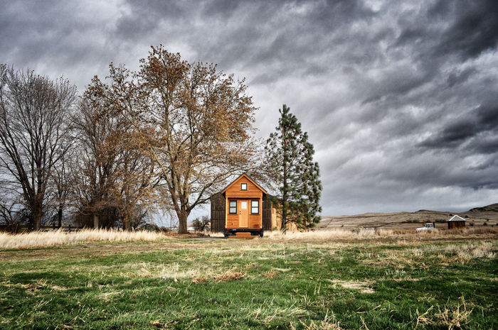 Tiny house in a windstorm. Architecture Building Exterior Cloud - Sky Cottage Landscape Little House Minimalism Nature No People Small House Tiny House  Tiny House On Wheels Tranquility