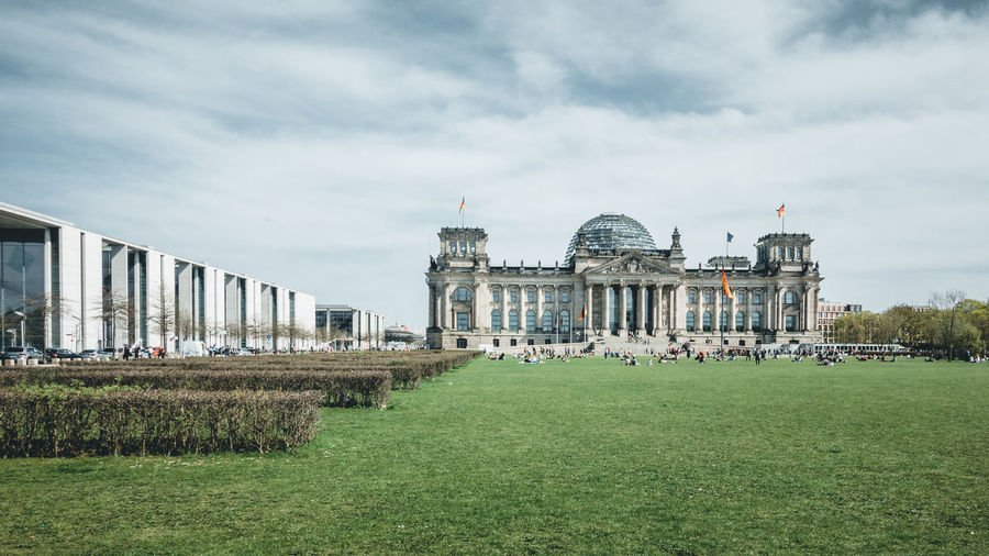 Reichstag building against cloudy sky