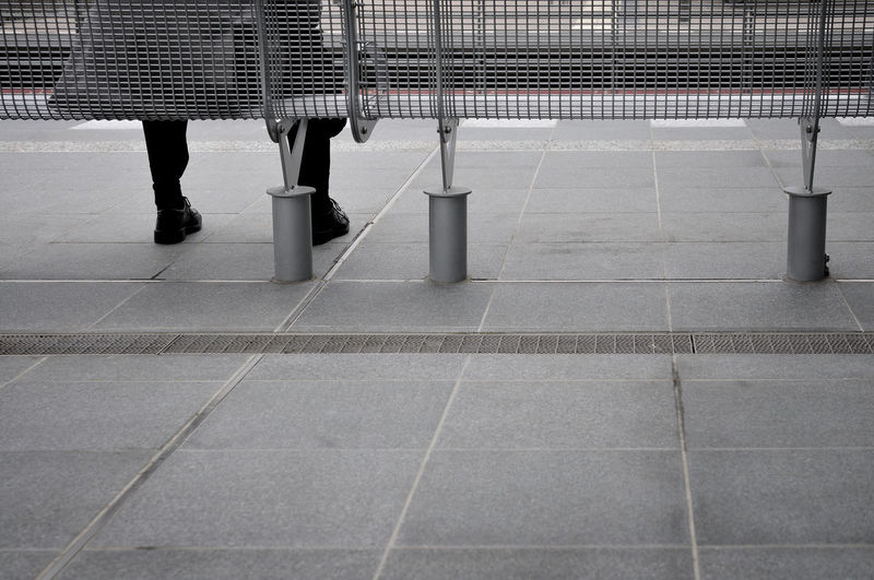 The Street Photographer - 2016 EyeEm Awards Sitting On A Bench Waiting Man Bench Platform Gray Alone City Life Loneliness Alone In The City  Copy Space