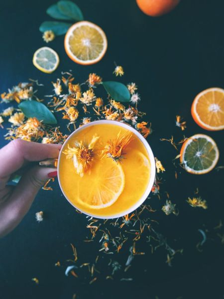 Herbs Marigold Dry Flowers Orange Juice  Cup In Hand Directly Above Fresh Drink Black Background Lemon Citrus Fruit Drink Healthy Eating Orange - Fruit Fruit SLICE