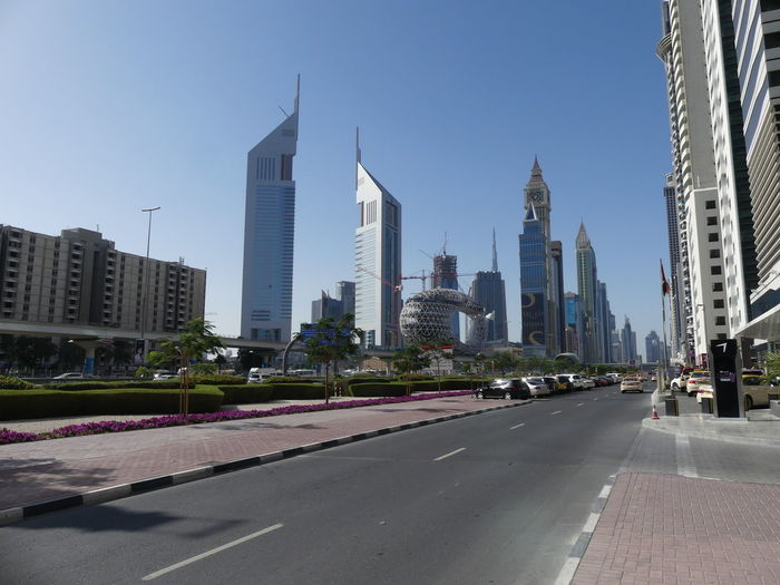 Sheik Zayed Road, Dubai, United Arab Emirates 2019 Dubai UAE 2019 Sheik Zayed Road Blue Sky Diatant View Skyscrapers Tower Blocks Towers No People Road City Cityscape Tall - High Clear Sky Sunlight And Shade City Street Motor Cars Composition Outdoor Photography Modern Design Modern Architecture Office Buildings Hotels Tourist Destination