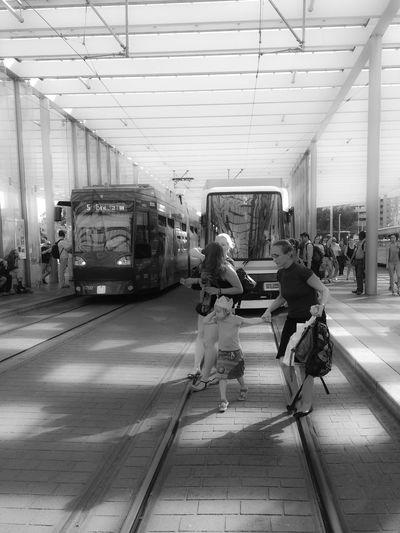 Woman looking at railroad station platform