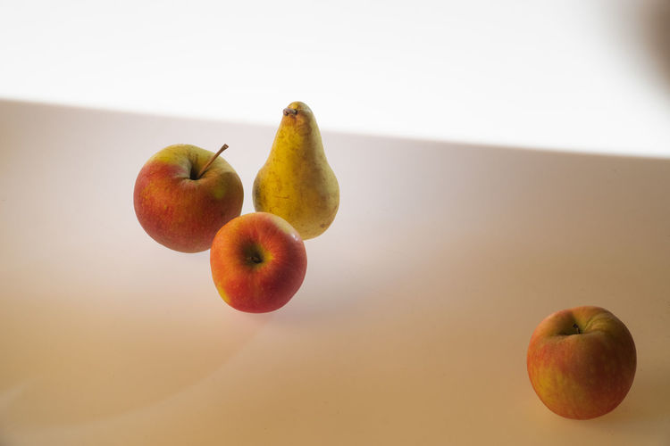 Practising with light and composition Composition Light Contrast Apple - Fruit Close-up Day Food And Drink Four Objects Freshness Fruit Group Of Objects Indoors  Light Table No People Orange Color Pear Practise Practise Session Rule Of Odds Still Life Studio Shot