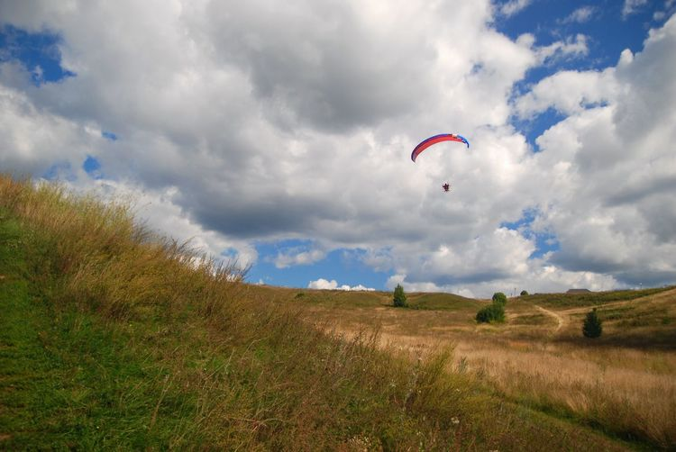 Paragliding over field