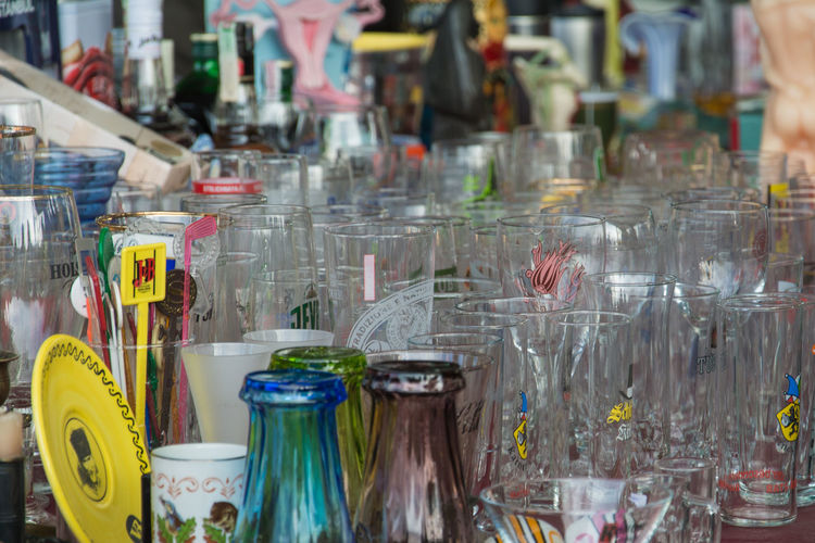 Abundance Bar Counter Choice Close-up Container Drinking Glass Focus On Foreground For Sale Glass Glass - Material Household Equipment Indoors  Jar Large Group Of Objects Messy Multi Colored No People Retail  Still Life Table Transparent Variation