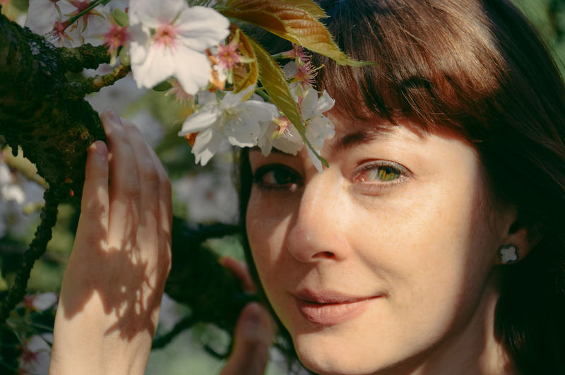 Close-up of woman with flowers