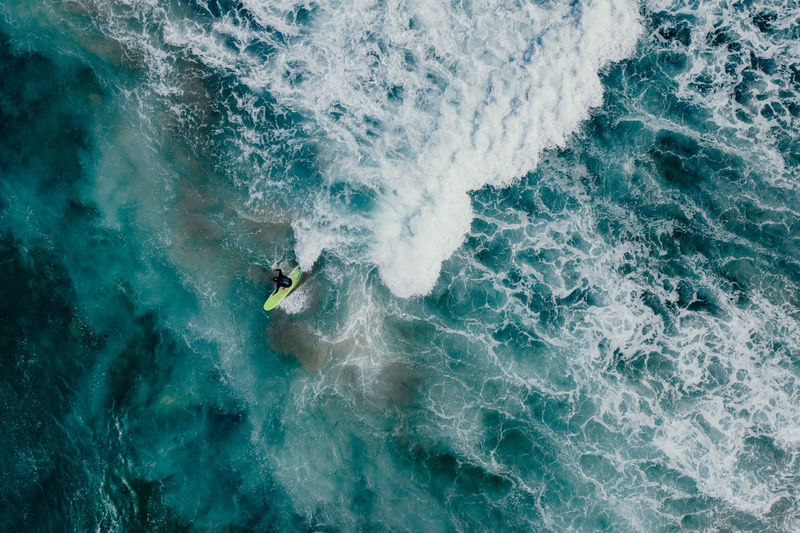 Sport Sea Water Motion Aquatic Sport High Angle View One Person Wave Surfing Nature Lifestyles Adventure Beauty In Nature Leisure Activity Day Extreme Sports Outdoors Men Power In Nature Turquoise Colored Surfer Water Sport Australia Aerial View Drone
