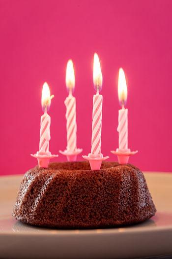 Burning candles on birthday cake
