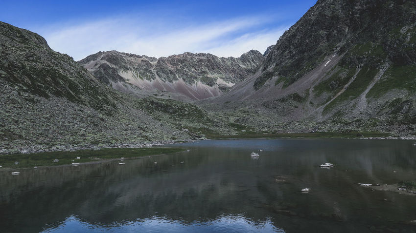 Early morning reflections on the mountain lake during a windy hour Beauty In Nature Day Lake Landscape Mountain Mountain Range Nature No People Non-urban Scene Outdoors Physical Geography Reflection Scenics Sky Tranquil Scene Tranquility Tree Water Waterfront