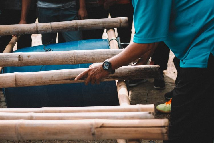 People making barrel raft