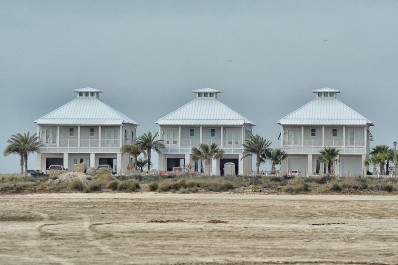 Houses on field against clear sky