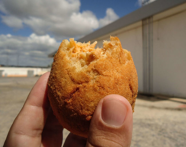 Holding a COXINHA DE FRANGO after being partially consumed. The COXINHA DE FRANGO is a very popular food in Brazil. This image was produced in May 2019. Appetiser Appetizer Background Bar Bar Snacks Brazil Brazilian Brazilian Food Brazilian Snack Chicken Closeup Cook  Coxinha Coxinha De Frango Coxinhas Cuisine Delicious Eat Food Frango Fresh Fried Fritada Galinha Gastronomy Gourmet Hand Hold Hot Isolated Kitchen Lanche Latin Lunch Meal Oil Original Food From Brazil Petisco Popular Salgadinho Salgado Savory Snack Snacks Stuffed Symbol Tasty Traditional Typical Unhealthy