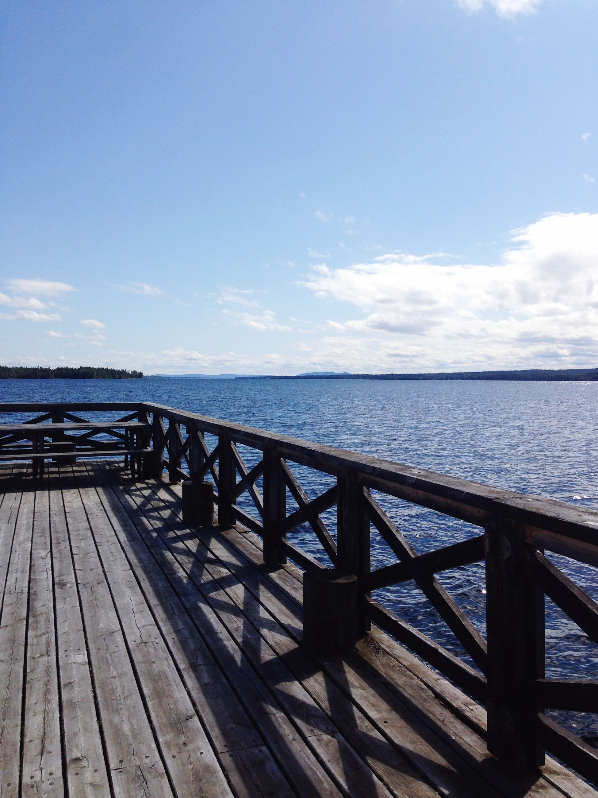 water, sea, pier, horizon over water, sky, railing, tranquil scene, tranquility, scenics, wood - material, jetty, beauty in nature, nature, blue, boardwalk, idyllic, wood, the way forward, cloud - sky, day