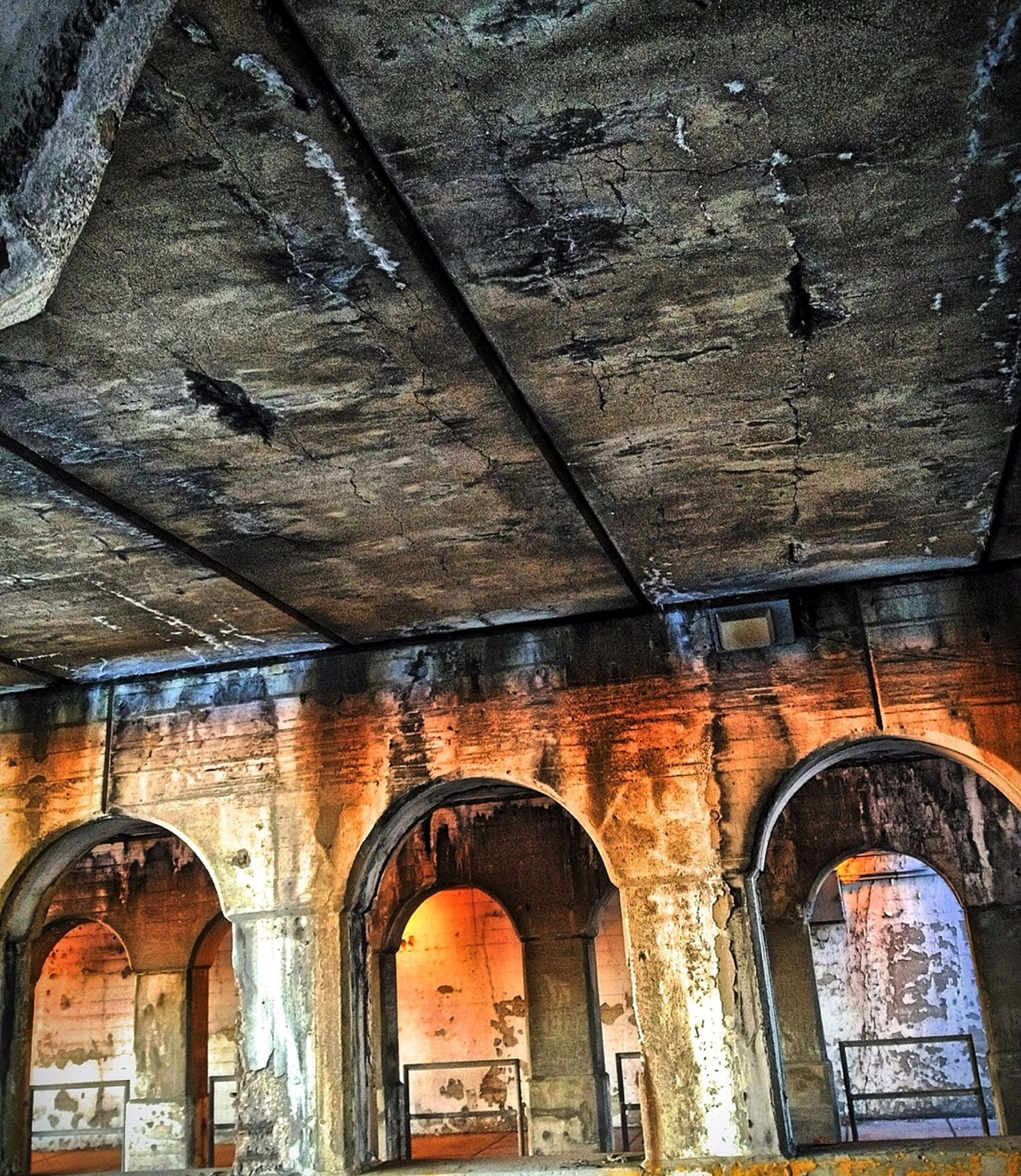 architecture, built structure, building exterior, window, low angle view, old, arch, building, wall - building feature, weathered, abandoned, wall, house, damaged, brick wall, no people, day, indoors, residential structure, deterioration