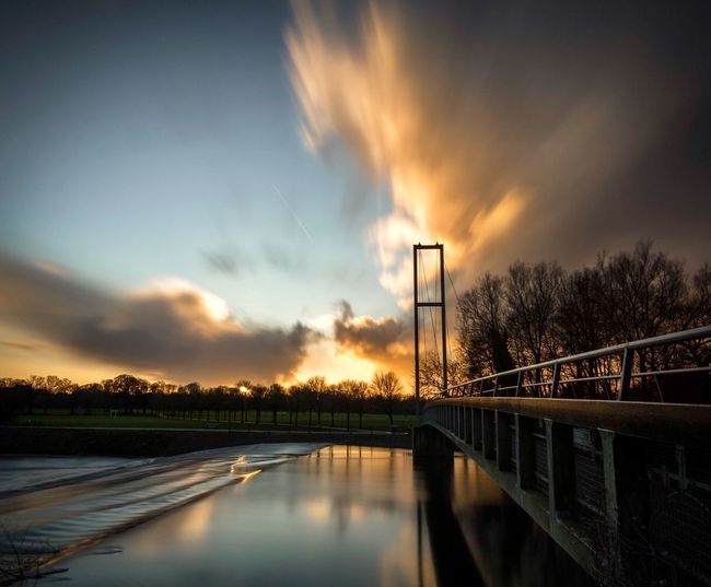 Water over the bridge Sunset Dusk Dusk In The City River Clouds Sky Sunset Sunset_collection No People Tree Tranquil Scene Outdoors Bridge - Man Made Structure Built Structure Architecture Scenics EyeEmNewHere EyeEmNewHere