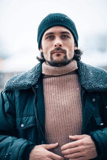 Man in city during snowfall
